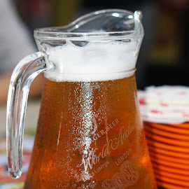 have a jug by Alice Chia - Food & Drink Alcohol & Drinks ( beer, bubbles, jug. lager, golden colour. )