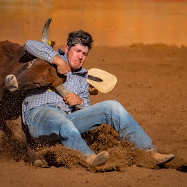 Steer Wrestling by Brent McKee - Sports & Fitness Rodeo/Bull Riding ( fuji x, qld, steer wrestling, rodeo, mount isa, boots )