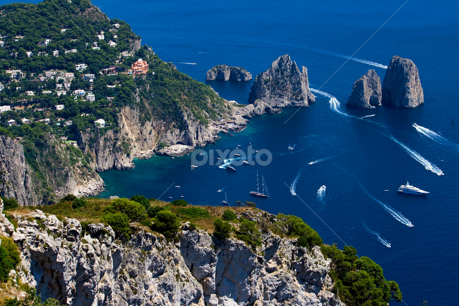 Capri by Francesco Riccardo Iacomino - Travel Locations Landmarks ( naples, europe, italian, relax, ocean, travel, beach, road, seaside, landscape, island, sky, tree, nature, capri, august, summertime, italy, light, tranquilize, water, catalog, boats, journey, sea, horizon, cristal, yachts, isle, european, blue, outdoor, hot, faraglioni, summer, air, view )