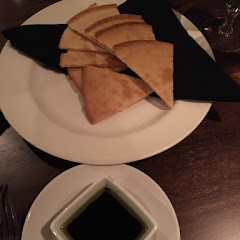 Flatbread and balsamic and olive oil dressing before meal