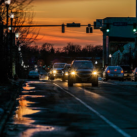 Main Street by Sandra Hilton Wagner - Transportation Automobiles ( headlights, puddles, cars, sunset, street, reflections, night, vibrant, streetlights, dusk, city,  )