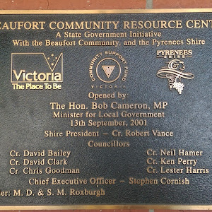 Plaque located on the side of a building in the main street. Reads: Beaufort Community Resource Centre A State Government initative With the Beaufort Community and the Pyrenees Shire [logos for ...
