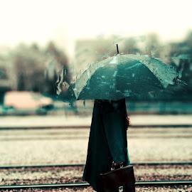 Waiting by Marko Brečić - Digital Art People ( car, rails, suitcase, waiting, umbrella, train, tram, people, man, rain )
