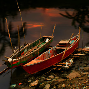 Boats on Shore by Jun Santos - Landscapes Waterscapes ( shore, boats, reflections, calm waters, dusk )