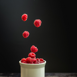 Flying raspberries by Marius Radu - Food & Drink Fruits & Vegetables ( fly, fruits, raspberyy, dark, food, cup,  )