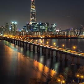 Lotte tower  by Aaron Choi - City,  Street & Park  Night ( night light, han, famous, highway, road, gangnam, architecture, travel, capital, asian, city, songpa, lights, han river, subway, skyscraper, iconic, asia, city lights, railway bridge, district, korea, nigthscape, jamsil, architectural detail, tourism, jamsil railway bridge, urban landscape, korean, destination, urban, gangbyeon, landmark, lotte tower, traffic, night view, railway, seoul, night, viewpoint, view, bridge, freeway, lotte, river )