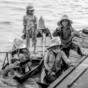 Young traders by Vibeke Friis - Black & White Street & Candid ( traders, selling, seim reap, cambodia,  )