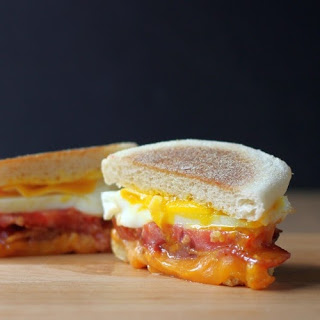 Bacon, Egg, Cheese and Tomato English Muffin Sandwich