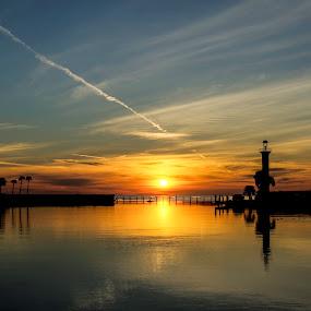Gulf Sunset by Christian Skilbeck - Landscapes Sunsets & Sunrises ( reflection, harbor, sunset, palm trees, lighthouse, ocean )