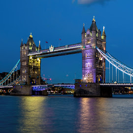 Tower Bridge at Night by Jan Murphy - Buildings & Architecture Bridges & Suspended Structures ( water, purple, reflections, vibrant, yellow, lights, colour, london, thames, blue, tower bridge, pink, night, bridge, embankment, swing bridge,  )