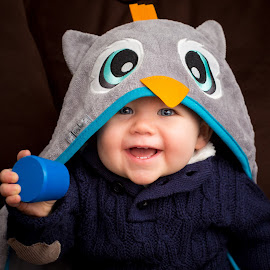 Baby Owl by Mike DeMicco - Babies & Children Toddlers ( babies, laugh, beautiful, cute, portrait, eyes, love, laughing, sweet, blue, towel, owl, adorable, baby, smile, boy )