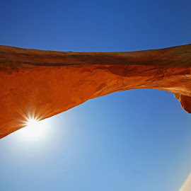 Sun under Wilson Arch by Justin Giffin - Landscapes Caves & Formations ( moab, arch, utah, formations, wilson arch, landscape )