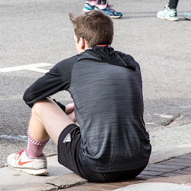 Resting After the Race by Thomas Shaw - Sports & Fitness Running ( shoes, socks, run, raleigh, north carolina, resting, sitting, krispy kreme challenge, shorts, bricks, runner, hair, man, sidewalk, marthon, shirt )