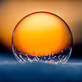 Sunset captured in a bubble by Roger Forsmark - Abstract Macro ( patterns, winter, soap bubble, sunsets, colors, sunset, beautiful, snow )