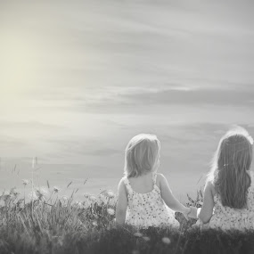 Sister Love by Shayne Janks Nicolas - Babies & Children Child Portraits ( field, love, skye, little girl, sisters, black and white, sunset, children, siblings, flowers, holding hands )