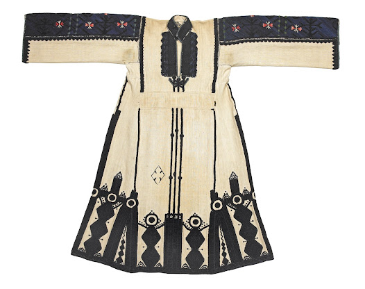 In 'Black Lamb and Grey Falcon', Rebecca West, travelling in Macedonia in the 1930s, said of the Skopska Crna Gora region, where this chemise comes from: 'They wear the most dignified and beautiful dresses of any of the Balkans, gowns of coarse linen embroidered with black wool in designs using the Christian symbols, which are at once abstract (being entirely unrepresentational) and charged with passionate feeling.'