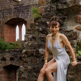 by Johannes Oehl - People Fashion ( muscular, romanesque, dress, castle, female hairstyle, 12th century, thigh, fashion-photography, apparel, rheinland-pfalz, lower arm, upper-arm, building, frankenstein castle, leg, beautiful, lightblue, up do, one female adult only, rhineland-palatinate, place of interest, medieval architecture, wardrobe, female, shoulder, costume, ruin, brickwork, pfalz, upper leg, german ethnicity, july, 11 brown iris, thin, red sandstone, person, looking at viewer, outside, stone wall, underarm, brick wall, germany, palatinate, martin-schultz scale, sandstone, 55-60 years, summer, bow window, brunette, lower leg, brick, europe, arm, architecture, 1 person, frankenstein, brunet, middle ages, sexy, medieval, people-photography, brown eyes, necklace, brown hair, clothes, dark mixed eyes, stone, outdoor, knee, jewellery, blue )