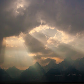 Sun Streaming through the Clouds by Jennifer  Loper  - Landscapes Sunsets & Sunrises ( beams, sunlight, streaming, grand tetons, jackson hole, wyoming,  )
