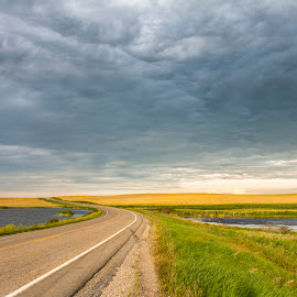 clouds rolling in by Praveen Mathew - Landscapes Cloud Formations ( clouds, winding road, landscape, storm, prairie )