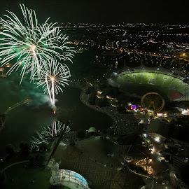 Firework at Olympic Park by Barbara Neider - City,  Street & Park  Night ( munich, firework, bird's eye view, green, from above, olympic stadium )