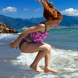 A day at the beach by Scot Love - Babies & Children Children Candids ( playing, mountains, girl, perfect timing, waves, vivid, children, ocean, beach, swimming )