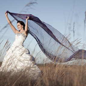 Blowing in the wind by Lood Goosen (LWG Photo) - Wedding Bride ( love, field, kiss, sunset kiss, bride and groom,  )