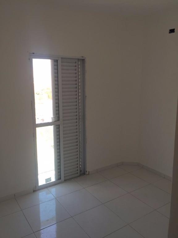 Apartamento com 2 dormitórios à venda, 62 m² por R$ 260.000 - Vila Voturua - São Vicente/SP