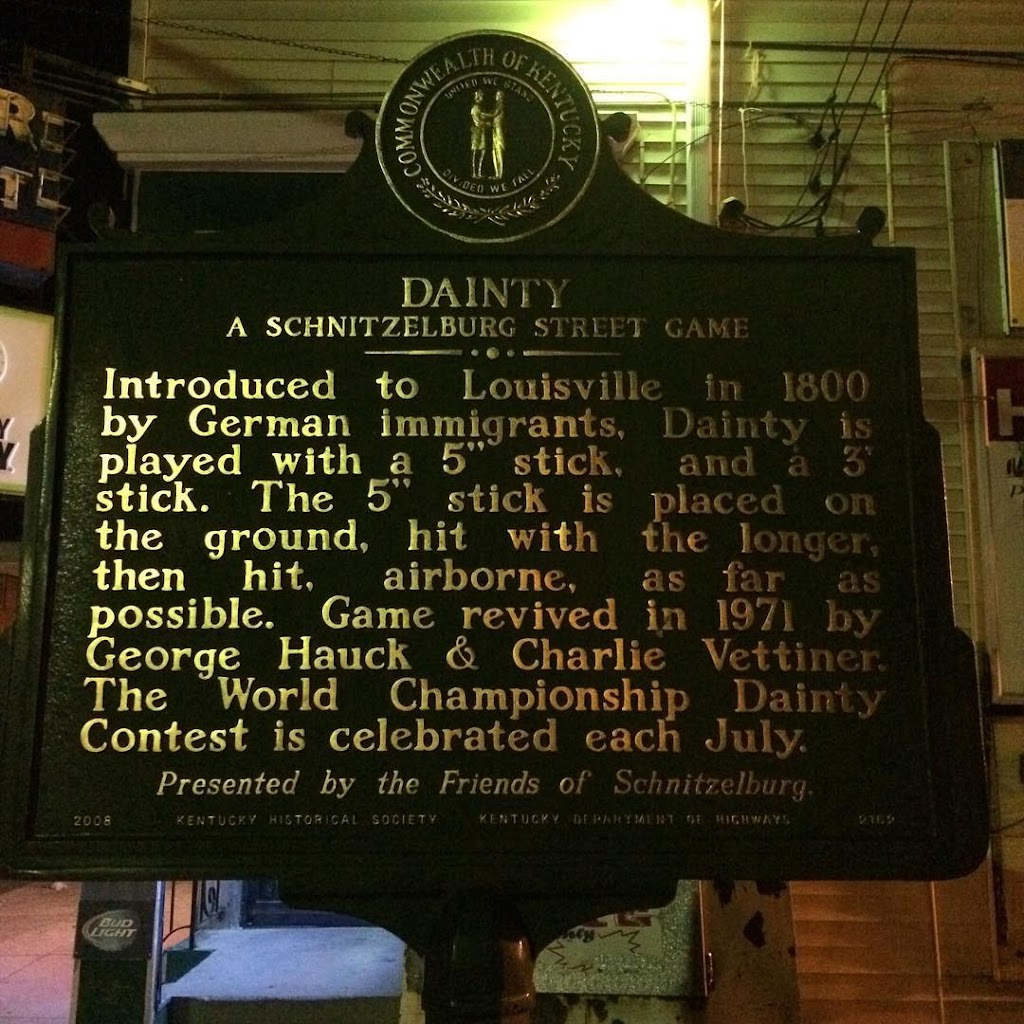 DAINTY A SCHNITZELBURG STREET GAME Introduced to Louisville in 1800by German immigrants, Dainty isplayed with a 5