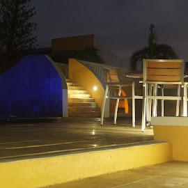 Poolside by Donald Henninger - City,  Street & Park  City Parks ( lights, night photography, pool, bonaire, sony alpha, long exposure, hotel, furniture, caribbean, island )