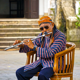 Street Musician at Lawang Sewu Semarang by Arif Perdana - People Musicians & Entertainers