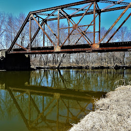 Iron Bridge Reflections by Kathy Woods Booth - Buildings & Architecture Bridges & Suspended Structures ( calm, mirrored reflections, tranquil, peaceful, trees, reflections, tranquility, bridge, iron, river )