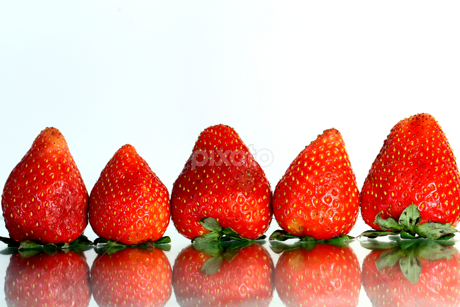 A row of strawberries. by Dipali S - Food & Drink Fruits & Vegetables ( fruit, reflection, red, food, www.dipalis.com, white, white background, strawberry, dipali s, pwc87,  )