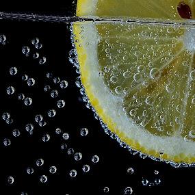 bubbling lemon by Pete G. Flores - Food & Drink Fruits & Vegetables ( water, fruit, vege, drop, bubbles, vegetables, yellow, soda, float, autofocus, foods, autofocusphotography, lemon,  )
