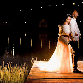 I had to share this photo from Storm Mhlambi & Thuso's wedding this weekend at St Ives in the Midlands. When I got there the previous day to walk around the venue I immediately knew that the jetty is going to be a great spot for the night shoot. The reflection on the water from the lights on the other side of the dam just gave such a romantic feel to the whole scene (www.junitastroh.com or follow me on instagram @ https://www.instagram.com/junita.stroh.fourie/ by Junita Fourie-Stroh - Wedding Bride & Groom