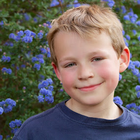 Boy in English Garden by Joe Proctor - Babies & Children Child Portraits ( eight year old, london, blue, satisfaction, flowers, boy, garden, west hampstead, smiling, portrait )