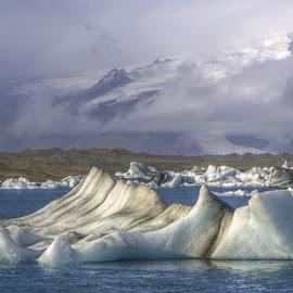 Jokulsarlon by Chris Kaiser - Landscapes Waterscapes ( clouds, iceberg, glacier, iceland, jokulsarlon, lagoon, jökulsárlón, lake, breiðamerkurjökull, island )