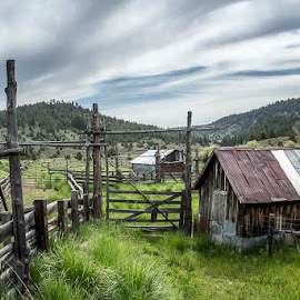 Eastern Oregon Cattle Pen by Andy Vic Brown - Buildings & Architecture Other Exteriors ( clouds, cattle holding, farm, hills, oregon, old )