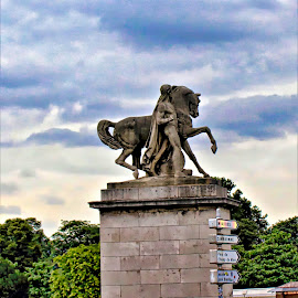 Statue in the sky by Bruce Newman - Buildings & Architecture Statues & Monuments ( colorful sky, colors, dramatic, artistic objects, landscape,  )