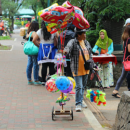 Buy and Sell by Carmina Quesada - City,  Street & Park  Street Scenes ( park scene, street scene, people, women, business )
