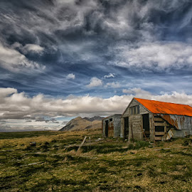 Shed by Þorsteinn H. Ingibergsson - Landscapes Cloud Formations ( farm, clouds, iceland, red, sky, nature, blue, structor, landscape, abandoned )