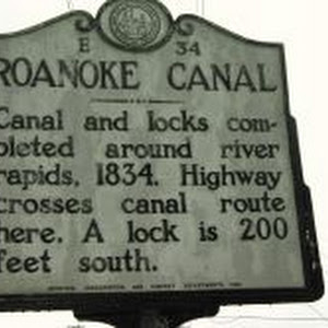 Canal and locks completed around river rapids, 1834. Highway crosses canal route here. A lock is 200 feet south.Plaque via North Carolina Highway Historical Marker Program, and is used with their ...