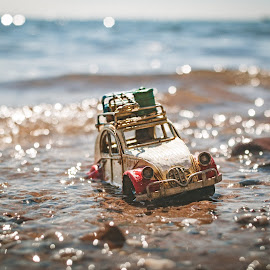 stranded by Graeme Smith - Artistic Objects Other Objects ( miniature car, car, sand, tin plate car, model car, model, tin plate model, citroen 2cv, beach, 2cv, citroen, miniature )