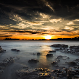 Sunset Glow by Chris James - Landscapes Beaches ( clouds, water, sunset, sea, beach, longexposure )