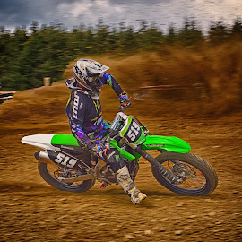 Dust Clouds In The Air ! by Marco Bertamé - Sports & Fitness Motorsports ( clouds, curve, speed, green, number, race, motocross, dust, clumps, 519, five hundred nineteen, alone, accelerating, competition,  )
