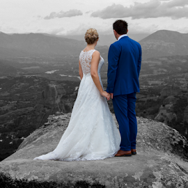 Looking Out by Rik Freeman - People Couples ( wedding photography, lovers, black and white, meteora, thessaly, greece, romantic, wedding dress, travel, romance, love, wedding photos destination, blackandwhite, travel location, views, wedding, wedding day, summer, scene, couple, scenery, travel photography, looking out,  )