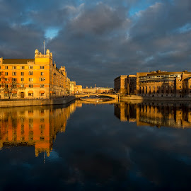 Stockholm by Robert Paulsen - Buildings & Architecture Bridges & Suspended Structures ( mirror, stockholm, blue, sunset, cloud )