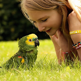 by Jane Bjerkli - Babies & Children Children Candids ( child, bird, amazon parrot, friends, girl, friendship, summer, summer feel )