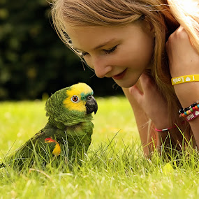 by Jane Bjerkli - Babies & Children Children Candids ( child, bird, amazon parrot, friends, girl, friendship, summer, summer feel )