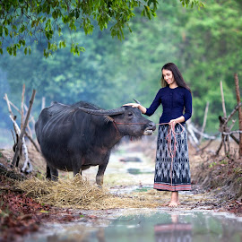 Asia girl and her buffalo in farm by Pitakchatr Thepracha - People Portraits of Women ( face, person, laos, holding, thailand, thai, beauty, rustic, people, asian, hat, fantasy, farm, curly, girl, nature, farmer, tale, woman, indonesia, family, happy, lifestyle, cambodian, wonder, asia, friendship, worker, cheerful, smiling, cambodia, animal, work, buffalo, rice, grass, green, beautiful, malaysia, leisure, happiness, ace, rural, myanmar, thailand farmer, female, legend, meadow, healthy, local )