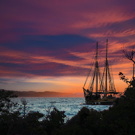 by Zoran Milutinovic - Landscapes Sunsets & Sunrises ( clouds, water, blue, matiu somes, sunset, wellington, sail boat, sun, new zealand, island )